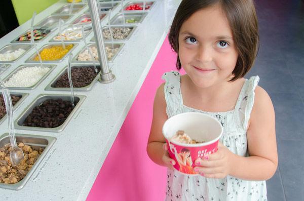 "<div class=""meta image-caption""><div class=""origin-logo origin-image none""><span>none</span></div><span class=""caption-text"">Sofia B. shows off the frozen yogurt dessert she created in the 'frozen yogurt district on Sunday, Aug. 30, 2015. (WABC Photo/ Mike Waterhouse)</span></div>"