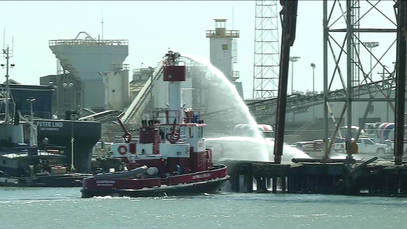 San Francisco's fireboat extinguished a small fire at Pier 90 near Amador and Third streets on Tuesday, September 1, 2015.