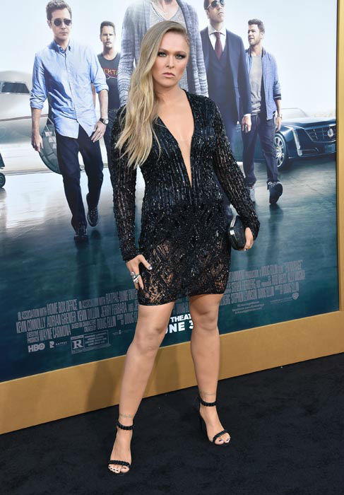 "<div class=""meta image-caption""><div class=""origin-logo origin-image none""><span>none</span></div><span class=""caption-text"">Ronda Rousey arrives at the Los Angeles premiere of ""Entourage"" at the Westwood Regency Village Theatre on Monday, June 1, 2015. (Photo/Rob Latour)</span></div>"