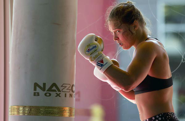 "<div class=""meta image-caption""><div class=""origin-logo origin-image none""><span>none</span></div><span class=""caption-text"">FILE - This July 15, 2015, file photo shows mixed martial arts fighter Ronda Rousey working out at Glendale Fighting Club in Glendale, Calif. (Photo/Jae C. Hong)</span></div>"