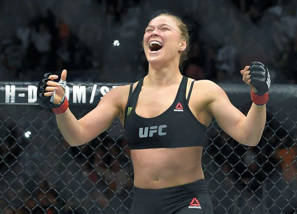 "<div class=""meta image-caption""><div class=""origin-logo origin-image none""><span>none</span></div><span class=""caption-text"">FILE - In this Feb. 28, 2015 file photo, Ronda Rousey, with Reebok insignia on her uniform, celebrates after defeating Cat Zingano in a UFC 184 fight. (Photo/Mark J. Terrill)</span></div>"
