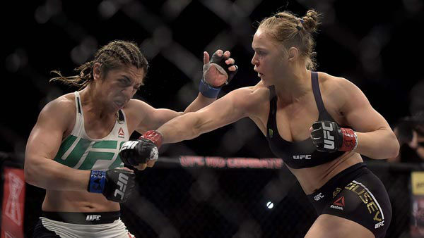 "<div class=""meta image-caption""><div class=""origin-logo origin-image none""><span>none</span></div><span class=""caption-text"">In this photo released by Inovafoto, Ronda Rousey, right, fights Brazil's Bethe Correia during their mixed martial arts bantamweight title fight at UFC 190 (AP Photo/ Alexandre Loureiro)</span></div>"