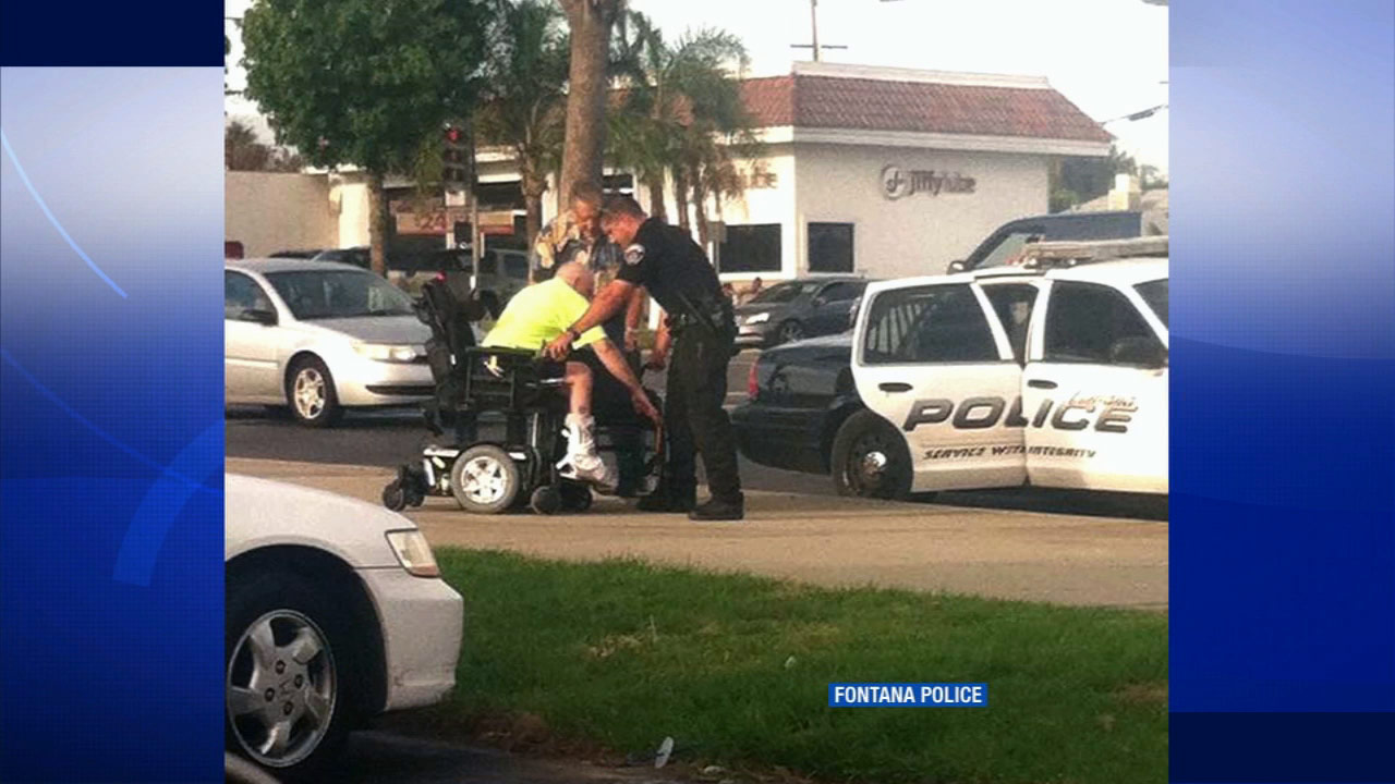Fontana police are seen helping a man stranded in wheelchair on Sept. 2, 2015.