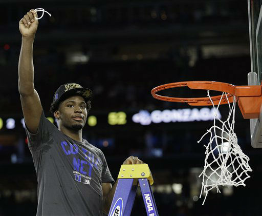 "<div class=""meta image-caption""><div class=""origin-logo origin-image none""><span>none</span></div><span class=""caption-text"">Duke's Justise Winslow holds part of the net after a college basketball regional final game against Gonzaga in the NCAA Tournament Sunday, March 29, in Houston. (AP Photo/ David J. Phillip)</span></div>"