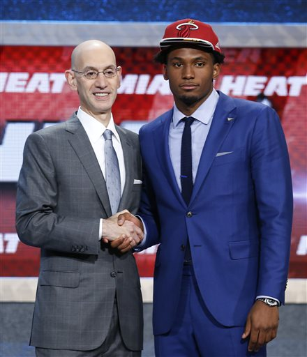 "<div class=""meta image-caption""><div class=""origin-logo origin-image none""><span>none</span></div><span class=""caption-text"">Justise Winslow poses for a photo with NBA Commissioner Adam Silver after being selected 10th overall by the Miami Heat during the NBA basketball draft, Thursday, June 25. (AP Photo/ Kathy Willens)</span></div>"