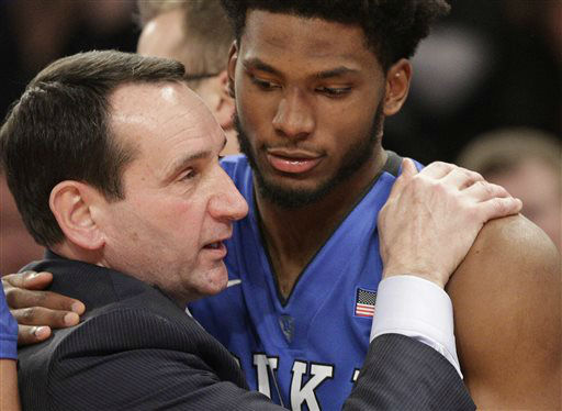 "<div class=""meta image-caption""><div class=""origin-logo origin-image none""><span>none</span></div><span class=""caption-text"">Duke head coach Mike Krzyzewski embraces Justise Winslow after winning his 1,000th game in an NCAA college basketball game. (AP Photo/ Kathy Willens)</span></div>"