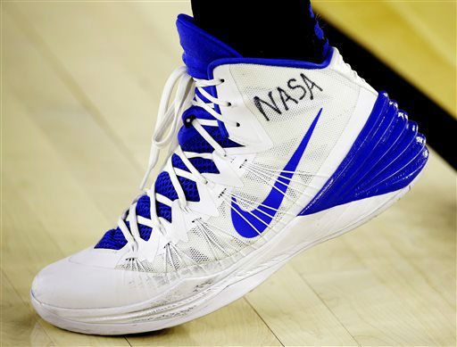 "<div class=""meta image-caption""><div class=""origin-logo origin-image none""><span>none</span></div><span class=""caption-text"">Justise Winslow has NASA written on his shoe at a college basketball regional semifinal game in the NCAA Tournament in Houston. (AP Photo/ David J. Phillip)</span></div>"