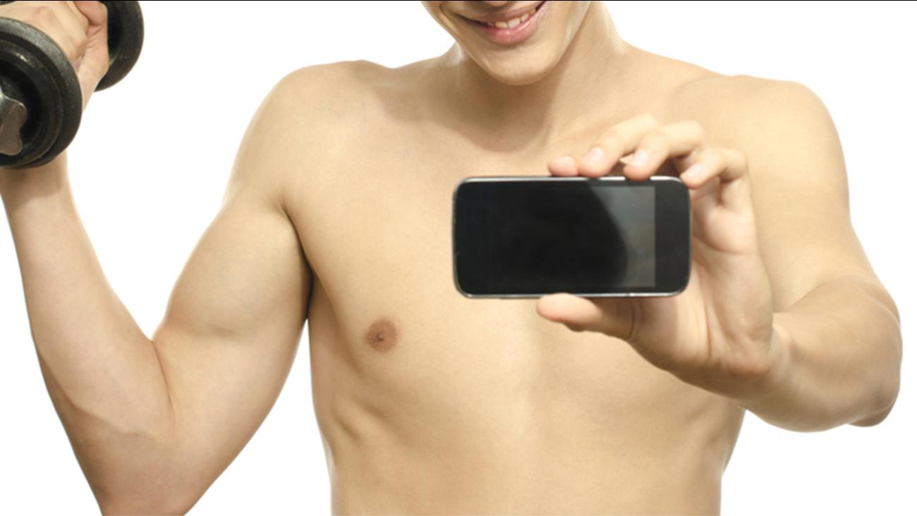 Man taking photo shirtless