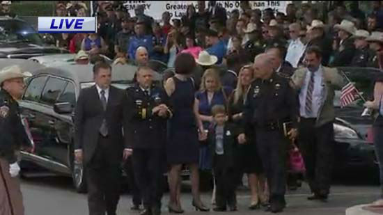 <div class='meta'><div class='origin-logo' data-origin='none'></div><span class='caption-text' data-credit='KTRK Photo/ KTRK'>Family members arrive to remember Deputy Darren Goforth at Second Baptist Church in Houston</span></div>