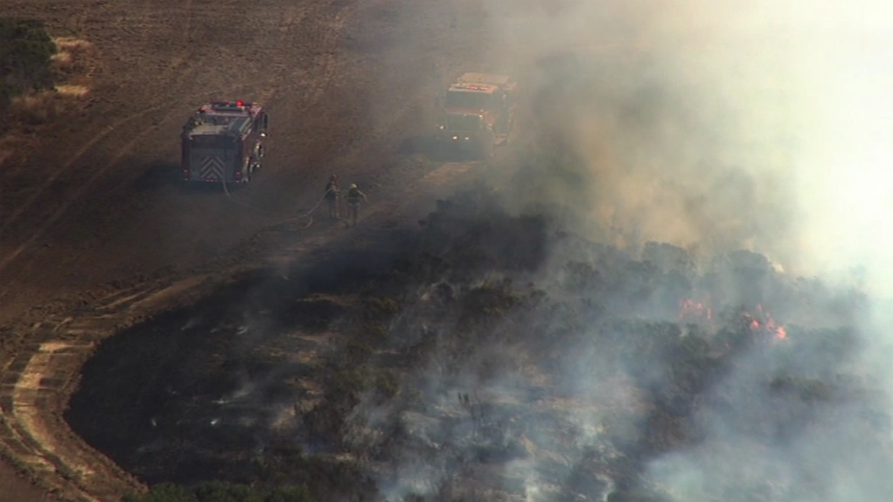 A brush fire near Belmont, Calif., shut down two northbound lanes Interstate Highway 280 on Friday, September 4, 2015.