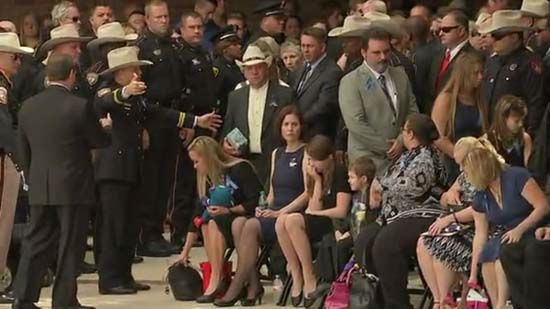 <div class='meta'><div class='origin-logo' data-origin='none'></div><span class='caption-text' data-credit='KTRK Photo/ KTRK'>Family and friends remember Deputy Darren Goforth at Second Baptist Church in Houston, September 4, 2015.</span></div>