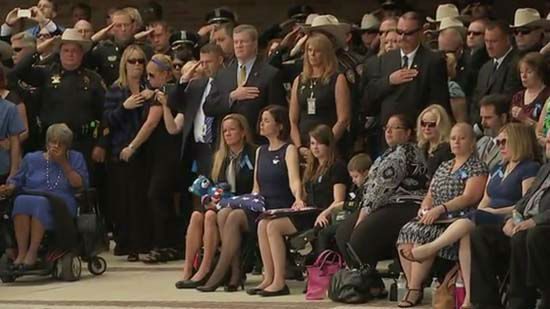 <div class='meta'><div class='origin-logo' data-origin='none'></div><span class='caption-text' data-credit='KTRK Photo/ KTRK'>Family and friends remember Deputy Darren Goforth at Second Baptist Church on September 4, 2015.</span></div>