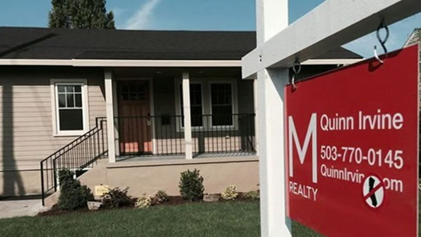 This M Realty for sale sign shows a map of California with a big red slash through it.