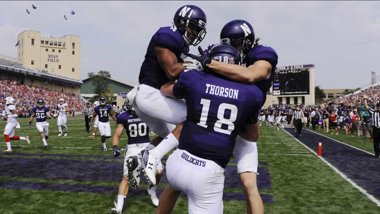 Northwestern quarterback Clayton Thorson celebrates after he ran for a touchdown against Stanford in an NCAA college football game in Evanston, Ill., Saturday, Sept. 5, 2015.