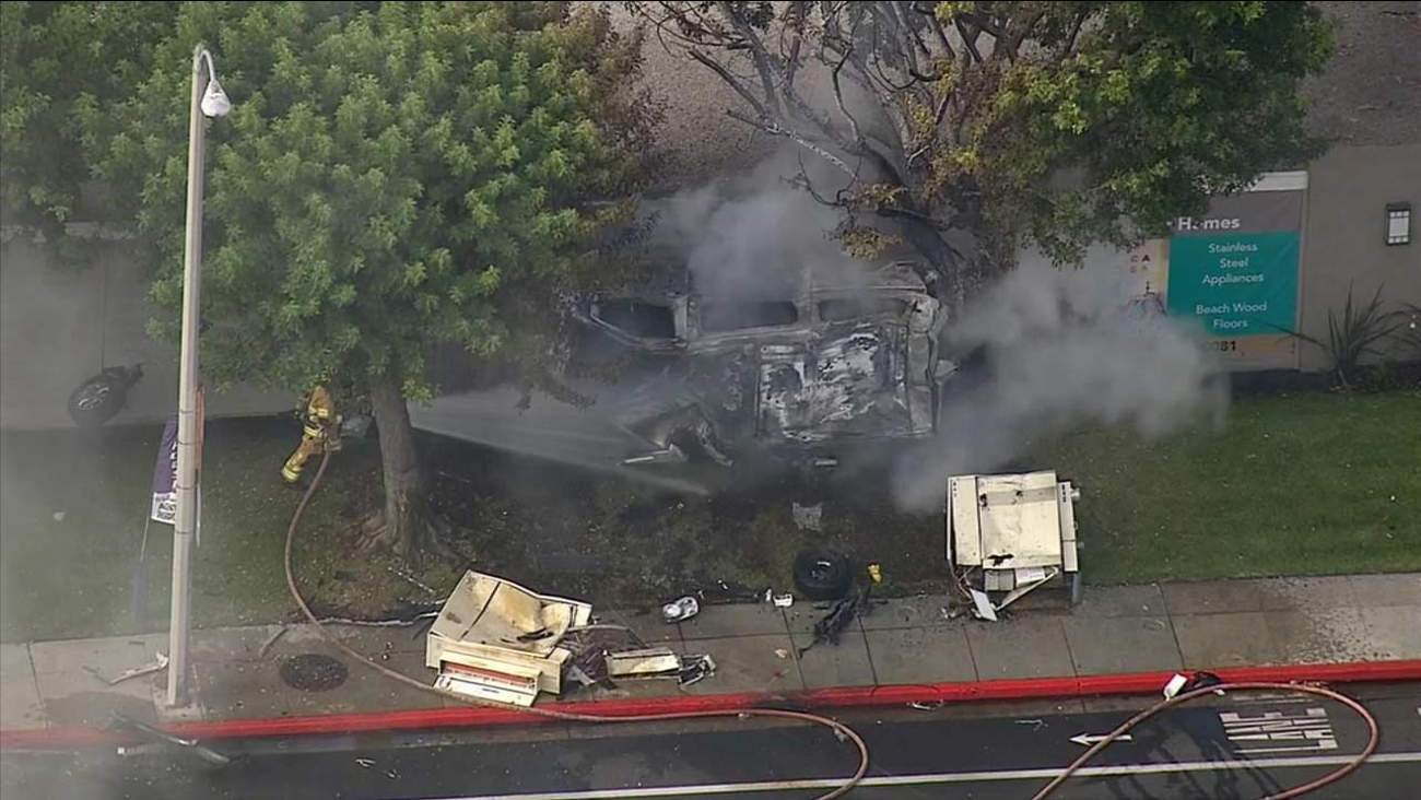 A van slammed into the side of a building, setting both the vehicle and the structure's wall on fire in Costa Mesa on Saturday, Sept. 5, 2015.