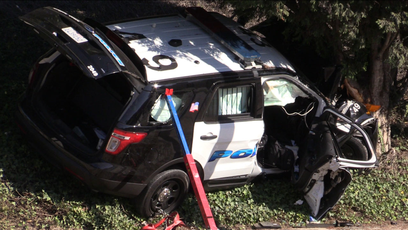 A mangled police car is shown after a Newport Beach police officer crashed the vehicle on Sunday, Sept. 6, 2015.