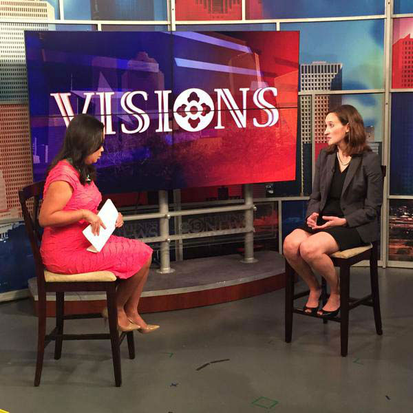 """<div class=""""meta image-caption""""><div class=""""origin-logo origin-image none""""><span>none</span></div><span class=""""caption-text"""">Miya Shay interviewing someone for Visions (KTRK Photo)</span></div>"""