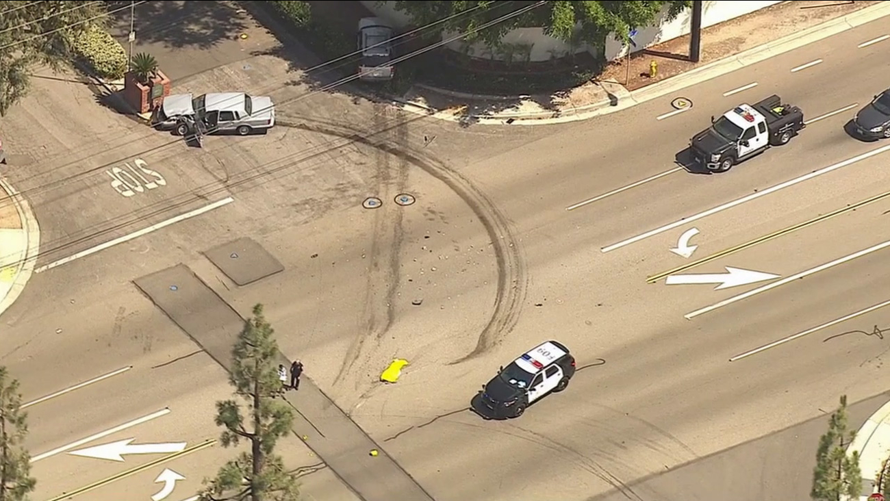 Authorities investigate the scene of a fatal two-car crash at a Fullerton intersection on Tuesday, Sept. 8, 2015.