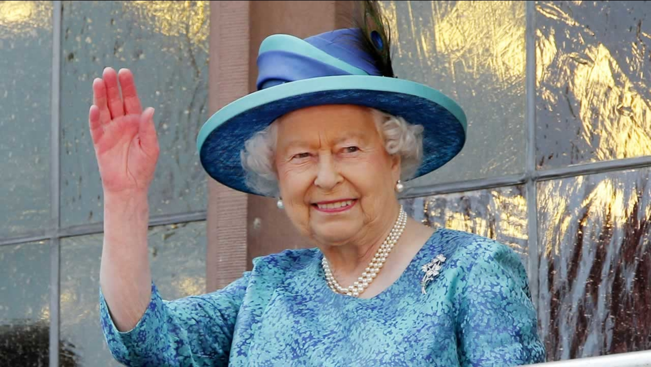 Britain's Queen Elizabeth II waves from the balcony of the Roemer town hall in Frankfurt, Germany, Thursday, June 25, 2015.