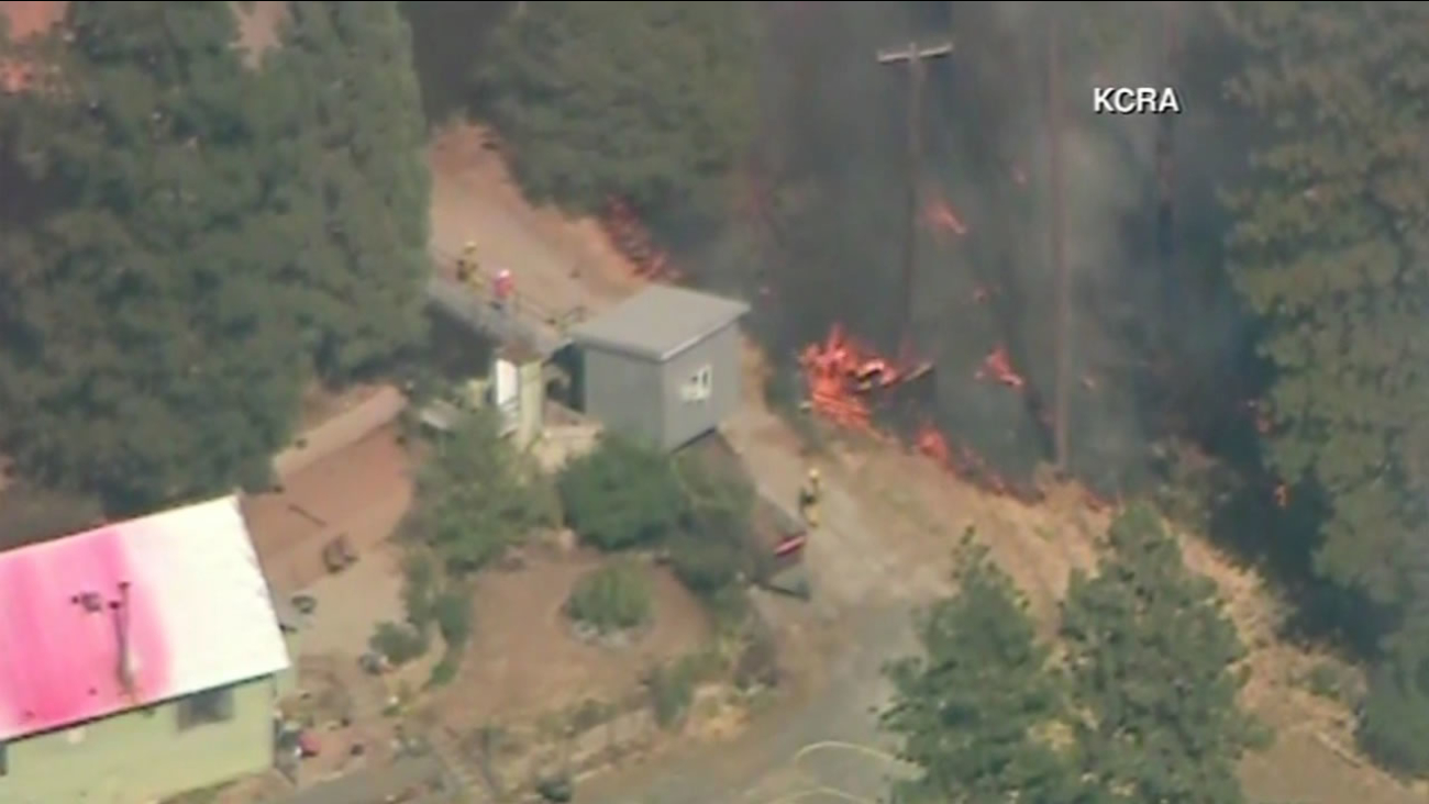 Homes have been evacuated in Tuolumne County because of two wildfires burning near Sonora Sept. 8, 2015.