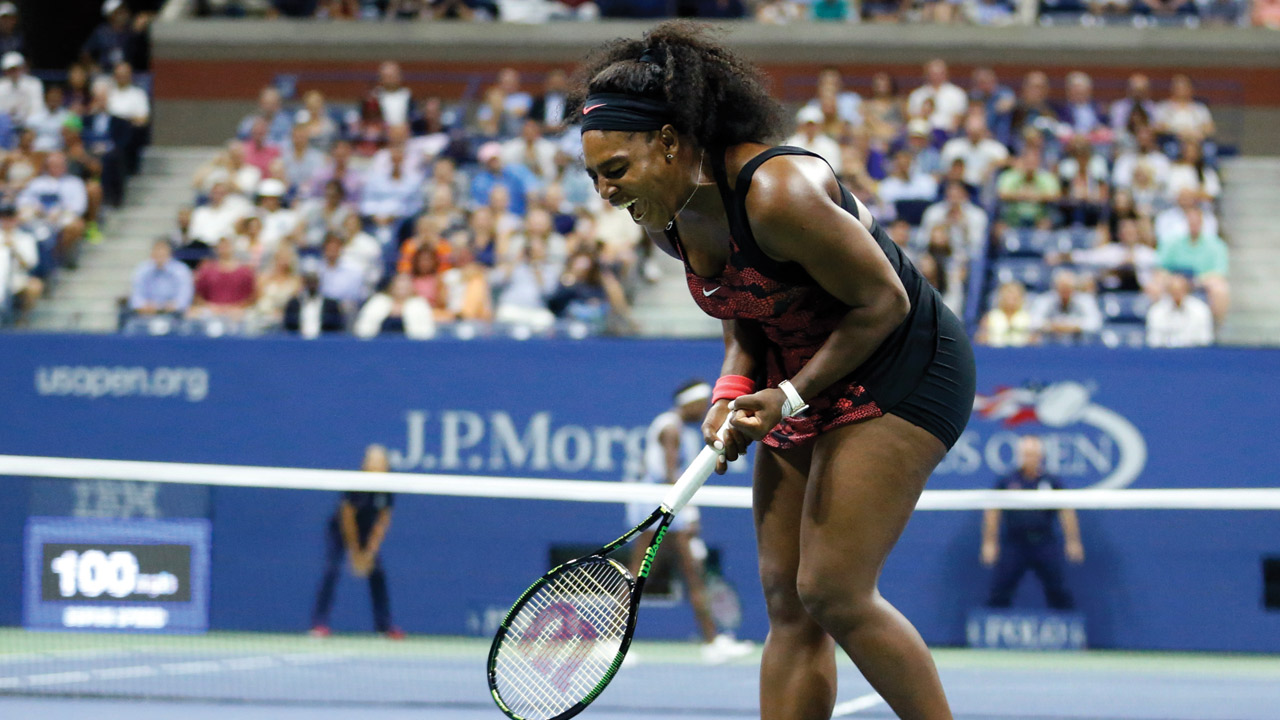 Serena Williams reacts after winning a point against Venus Williams during a quarterfinal match at the U.S. Open tennis tournament, Tuesday, Sept. 8, 2015, in New York.