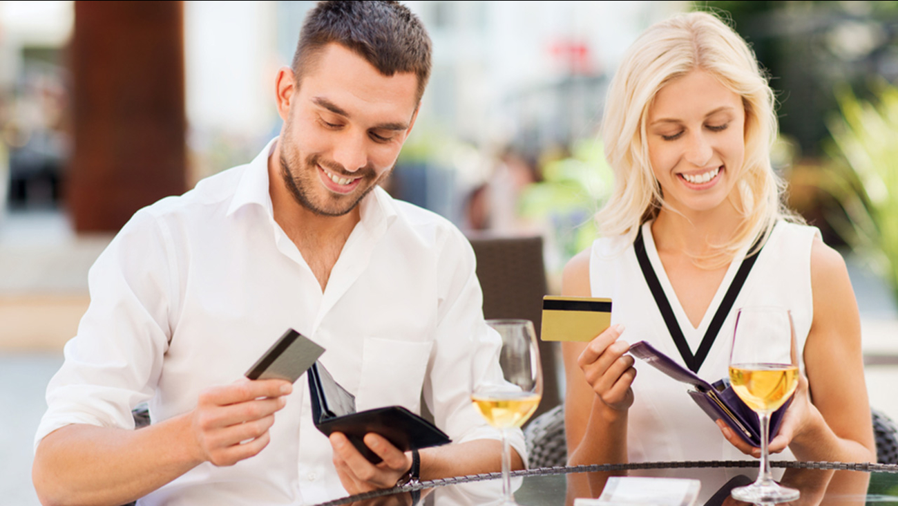 Man and woman paying for date