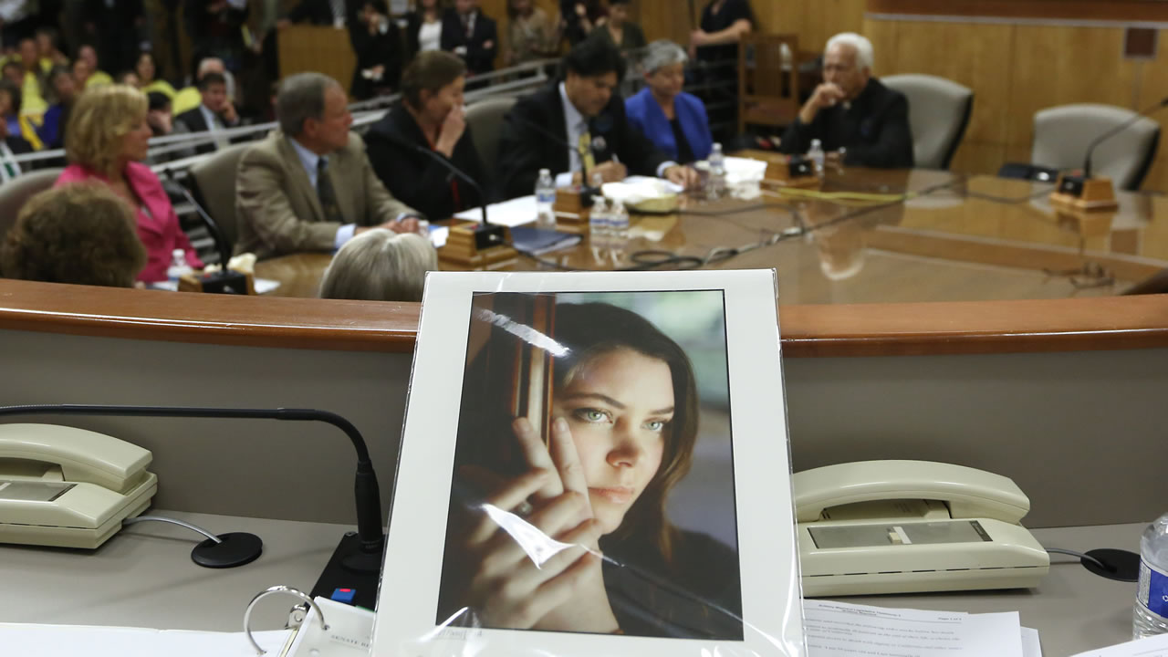 FILE - In this March 25, 2015, file photo, a portrait of Brittany Maynard sits on the dias of the Senate Health Committee at the Capitol in Sacramento, Calif. (AP Photo)