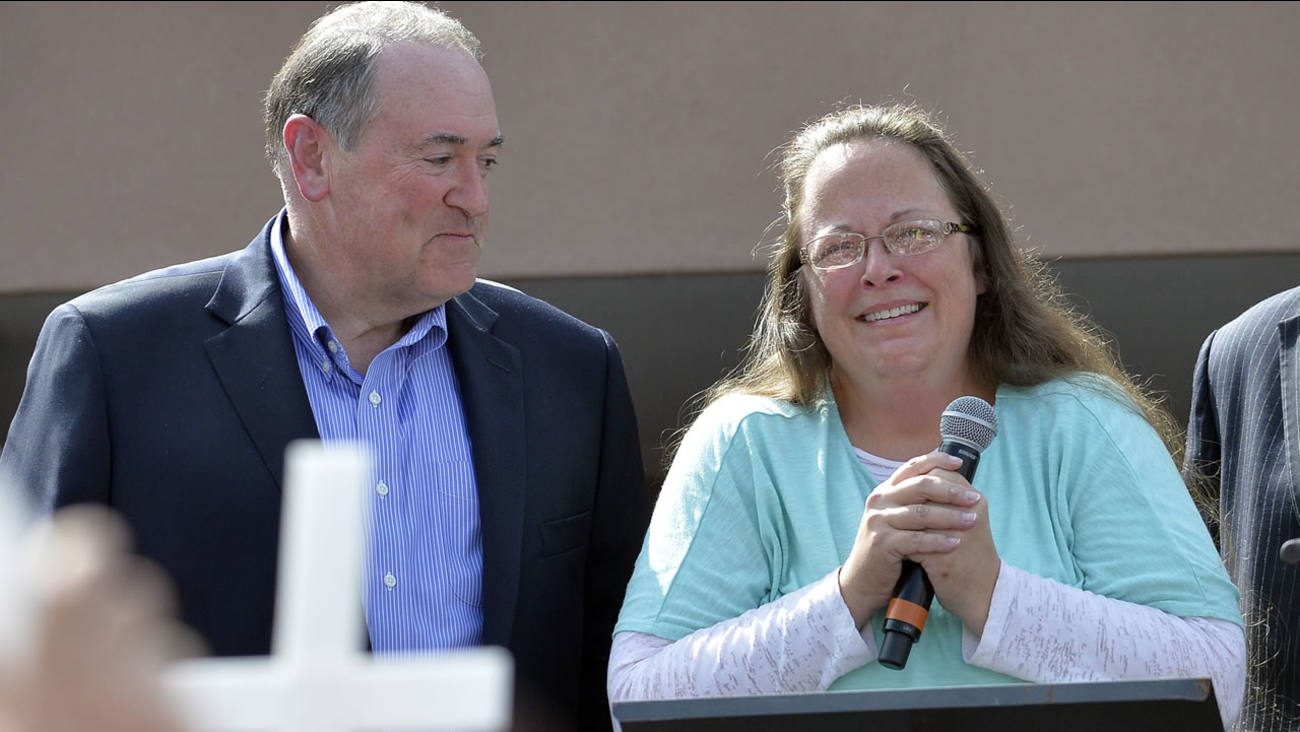 Rowan County Clerk Kim Davis, with Republican presidential candidate Mike Huckabee at her side speaks after being released from jail on Tuesday, Sept. 8, 2015, in Grayson, Ky. (AP Photo)