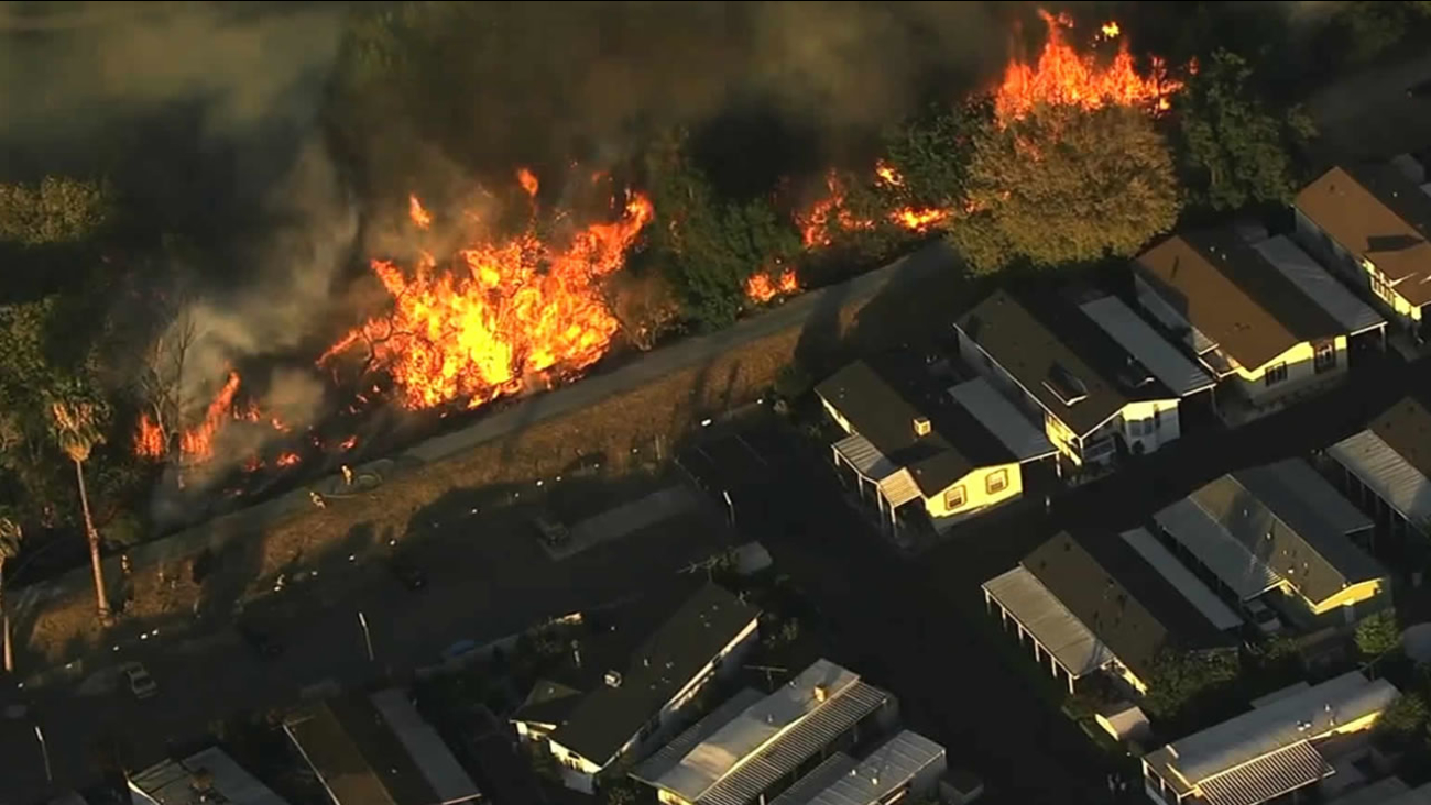 Crews battled a fast-moving grass fire that started burning next to a mobile home park in San Jose, Calif. on Wednesday, September 9, 2015.