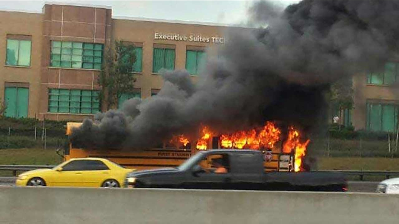 A school bus carrying water polo athletes erupted in flames on the northbound 5 Freeway near the Jeffrey Road exit in Irvine on Wednesday, Sept. 9, 2015.