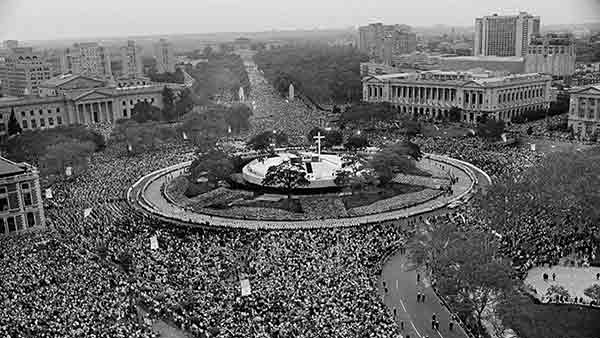 """<div class=""""meta image-caption""""><div class=""""origin-logo origin-image ap""""><span>AP</span></div><span class=""""caption-text"""">In this Oct. 3, 1979 file photo Pope John Paul II performs an outdoor mass for a huge audience at Logan Circle in Philadelphia.</span></div>"""