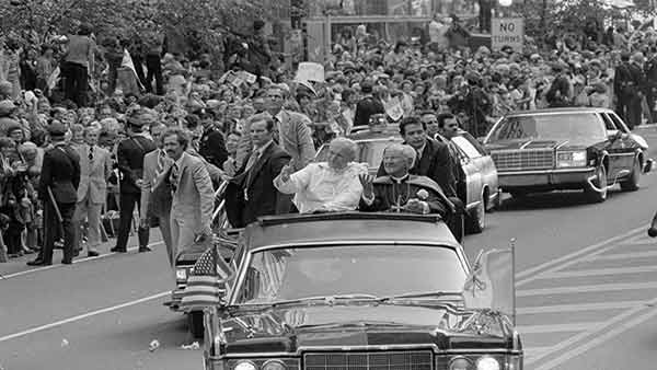"""<div class=""""meta image-caption""""><div class=""""origin-logo origin-image ap""""><span>AP</span></div><span class=""""caption-text"""">Pope John Paul II, in white, and Cardinal John Krol wave to the crowd welcoming the Pontiff to Philadelphia, Pa., Oct. 3, 1979. (Jack Kanthal)</span></div>"""