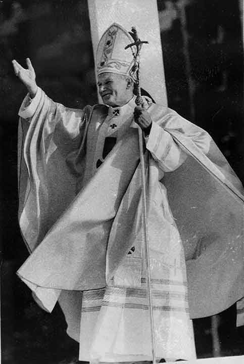 """<div class=""""meta image-caption""""><div class=""""origin-logo origin-image ap""""><span>AP</span></div><span class=""""caption-text"""">With his robes flowing in the breeze, Pope John Paul II gestures to a huge crowd attending an outdoor mass at Logan Circle in Philadelphia, Pa., Oct. 3, 1979. (Rusty Kennedy)</span></div>"""