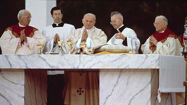 "<div class=""meta image-caption""><div class=""origin-logo origin-image ap""><span>AP</span></div><span class=""caption-text"">Pope John Paul II performs an outdoor mass in Philadelphia, Pa., Oct. 3, 1979.</span></div>"
