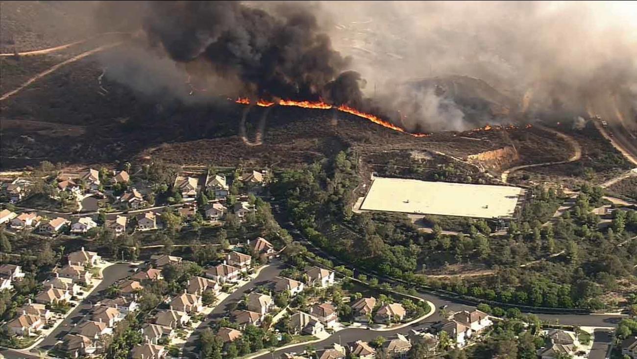 Flames burn through brush on a La Habra hillside near the Fullerton border on Tuesday, Sept. 8, 2015.