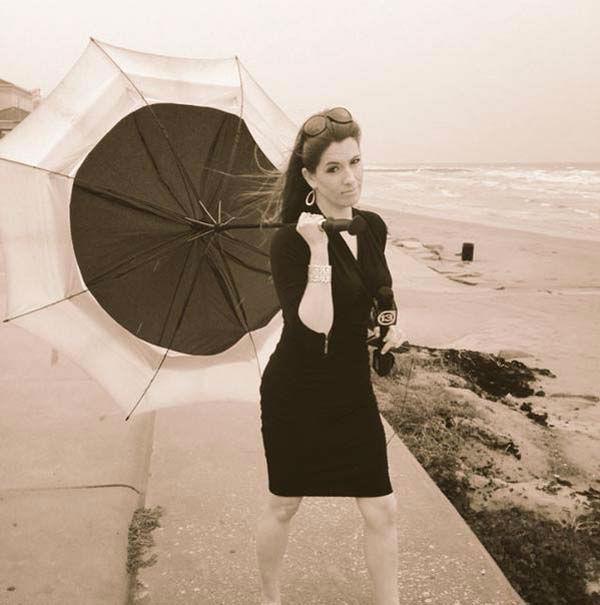 "<div class=""meta image-caption""><div class=""origin-logo origin-image none""><span>none</span></div><span class=""caption-text"">Natasha wasn't having the best luck with this umbrella in Galveston (KTRK Photo)</span></div>"