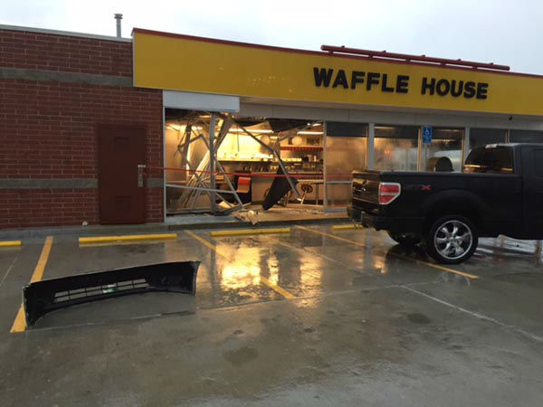 "<div class=""meta image-caption""><div class=""origin-logo origin-image none""><span>none</span></div><span class=""caption-text"">A pickup truck slammed into the front of a Waffle House restaurant off West Little York near Fry Road.</span></div>"