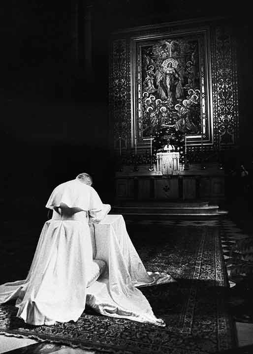 """<div class=""""meta image-caption""""><div class=""""origin-logo origin-image ap""""><span>AP</span></div><span class=""""caption-text"""">Pope John Paul II prays at St. Peter and Paul Cathedral in Philadelphia, Pa., Oct. 3, 1979.</span></div>"""