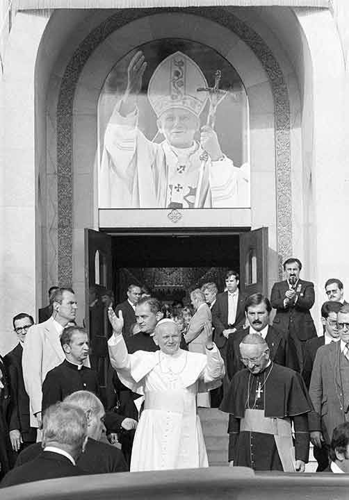 """<div class=""""meta image-caption""""><div class=""""origin-logo origin-image ap""""><span>AP</span></div><span class=""""caption-text"""">Pope John Paul II waves to the crowd in front of the Ukrainian Church in Philadelphia, Pa., Oct. 4, 1979. At right is Cardinal John Krol of Philadelphia. (Paul Vathis)</span></div>"""