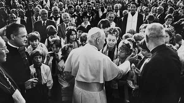"""<div class=""""meta image-caption""""><div class=""""origin-logo origin-image ap""""><span>AP</span></div><span class=""""caption-text"""">Pope John Paul II touches one of the children gathered in front of the Ukrainian Church in Philadelphia, Pa., Oct. 4, 1979.</span></div>"""