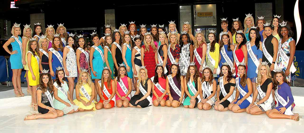 "<div class=""meta image-caption""><div class=""origin-logo origin-image ap""><span>AP</span></div><span class=""caption-text"">In this image released by Starpix, 52 Miss America contestants pose with reigning Miss America 2015 Kira Kazantsev on Tuesday, Sept. 1, 2015 in New York's Times Square. (AP Photo/Wayne Parry)</span></div>"
