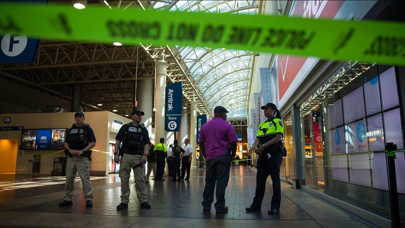 Police and emergency responders stand outside a McDonald's located inside Union Station in Washington, Friday, Sept. 11, 2015