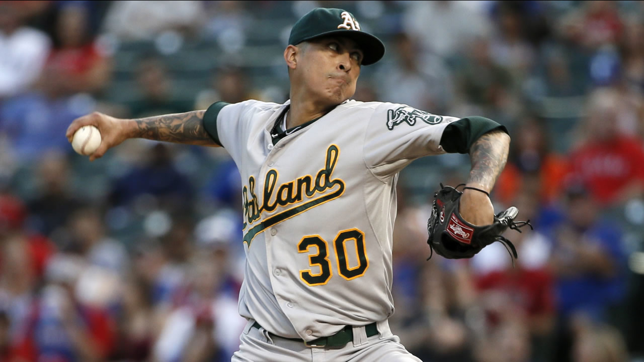 Oakland Athletics starting pitcher Jesse Chavez works against the Texas Rangers during the first inning of a baseball game Friday, Sept. 11, 2015, in Arlington, Texas.