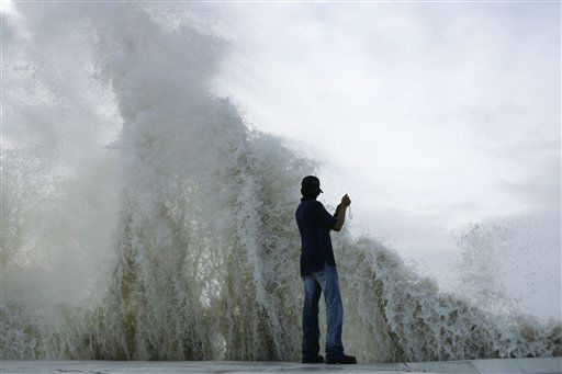 "<div class=""meta image-caption""><div class=""origin-logo origin-image none""><span>none</span></div><span class=""caption-text"">Daniel Gallegos photographs as waves from approaching Hurricane Ike crash into the seawall, Friday, Sept. 12, 2008, in Galveston, Texas. (AP Photo/Matt Slocum) (AP Photo/ Matt Slocum)</span></div>"