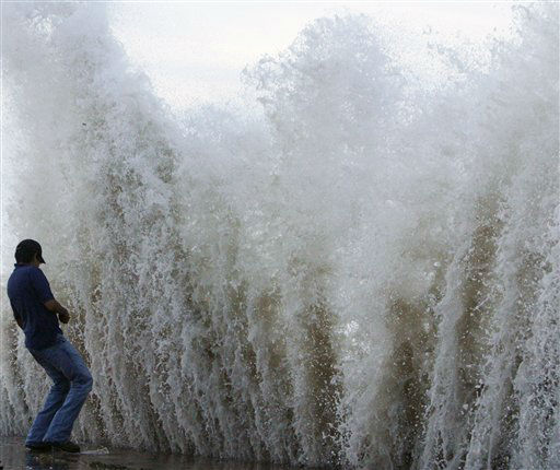 <div class='meta'><div class='origin-logo' data-origin='none'></div><span class='caption-text' data-credit='AP Photo/ Matt Slocum'>Daniel Gallegos watches as a wave crashes into the seawall as Hurricane Ike approaches the Texas coast, Friday, Sept. 12, 2008, in Galveston, Texas. (AP Photo/Matt Slocum)</span></div>