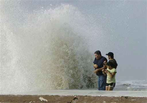 "<div class=""meta image-caption""><div class=""origin-logo origin-image none""><span>none</span></div><span class=""caption-text"">A family watches as waves from approaching Hurricane Ike crash into the seawall, Friday, Sept. 12, 2008, in Galveston, Texas. (AP Photo/Matt Slocum) (AP Photo/ Matt Slocum)</span></div>"
