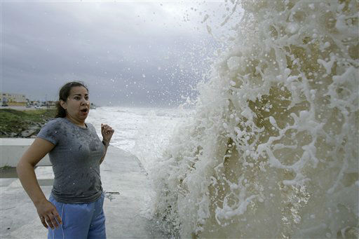 <div class='meta'><div class='origin-logo' data-origin='none'></div><span class='caption-text' data-credit='AP Photo/ Matt Slocum'>Sylvia Renteria, of Houston, watches a big wave caused by approaching Hurricane Ike crash into the seawall, Friday, Sept. 12, 2008, in Galveston, Texas. (AP Photo/Matt Slocum)</span></div>