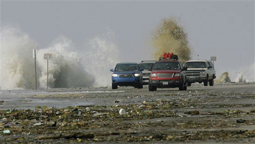 <div class='meta'><div class='origin-logo' data-origin='none'></div><span class='caption-text' data-credit='AP Photo/ Matt Slocum'>Traffic drives through debris along the seawall as waves crash in from Hurricane Ike, Friday, Sept. 12, 2008, in Galveston, Texas. (AP Photo/Matt Slocum)</span></div>