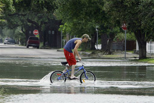 "<div class=""meta image-caption""><div class=""origin-logo origin-image none""><span>none</span></div><span class=""caption-text"">A person rides his bike through a flooded street near downtown Galveston, Texas, as Hurricane Ike approaches the Texas coast, Friday, Sept. 12, 2008. (AP Photo/Matt Slocum) (AP Photo/ Matt Slocum)</span></div>"