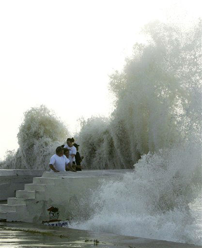 <div class='meta'><div class='origin-logo' data-origin='none'></div><span class='caption-text' data-credit='AP Photo/ Matt Slocum'>People pull back as a wave crashes against the seawall as Hurricane Ike approaches the Texas coast, Friday, Sept. 12, 2008, in Galveston, Texas. (AP Photo/Matt Slocum)</span></div>